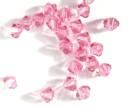 40 toupies cristal swarovski 4mm light rose